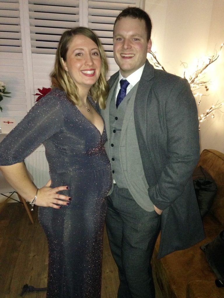 Happy pregnant couple NYE